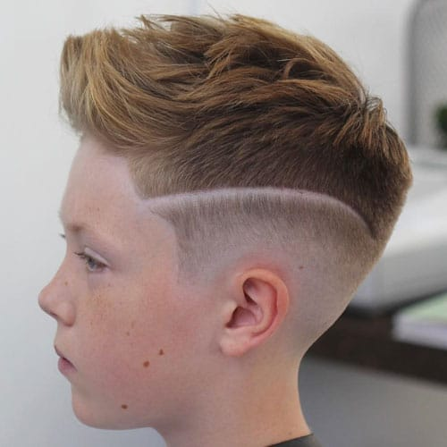 Low-Bald-Fade-with-Design-and-Brushed-Up-Hair