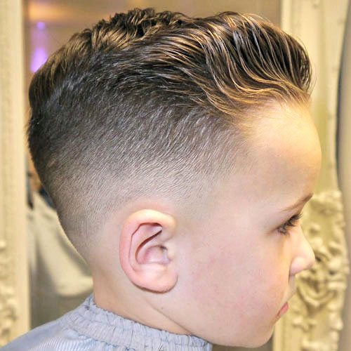 Low-Bald-Fade-with-Wavy-Brushed-Back-Hair